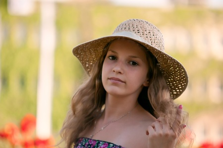 Portrait of teen girl in a straw hat. photo