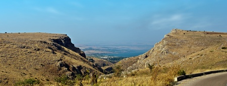 View of the Sea of Galilee (Lake Kinneret) through the mountains. photo