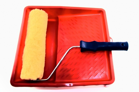Roller for painting on a red tray. Stock Photo - 10080782