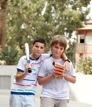 Boys with a baseball glove and a baseball bat. Stock Photo - 10351002