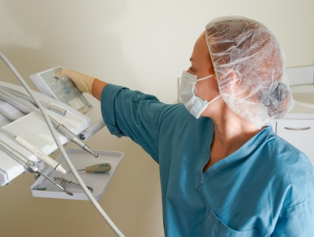 A portrait of a female dentist in a clinic . photo