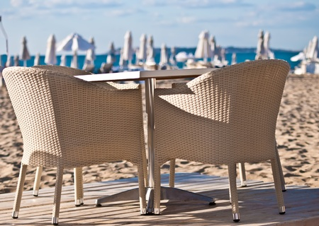 Table and wicker chairs beach cafe. Stock Photo - 10212929