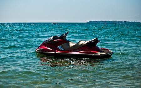 Red jet ski in the sea . photo
