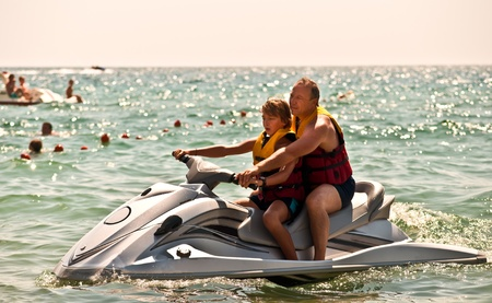 jetski: Happy family on the water in the sea .