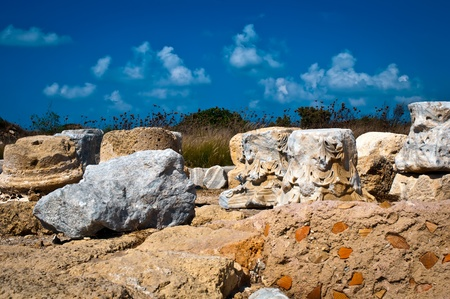 Ruins of old column in Caesarea . Israel . photo