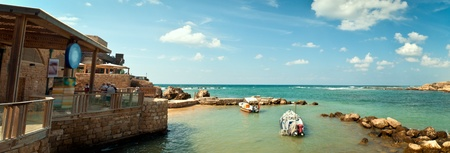 Old port of Caesarea in Israel with crystal clear water Historical landmark .