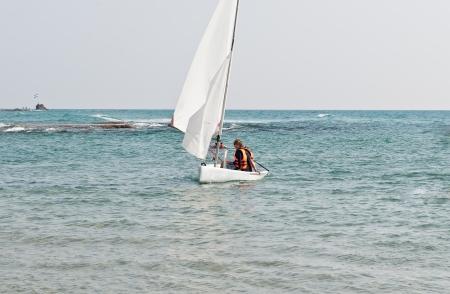 yam israel: Teenagers learning sailing boat  sailing on the coast of Bat Yam   Israel