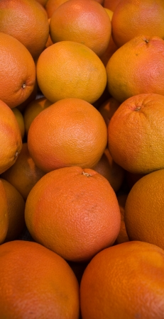 Fresh natural oranges to background