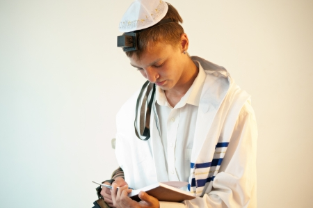 Religious Jewish teenager with a book in hand   photo