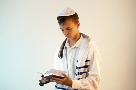 Religious Jewish teenager with a book in hand