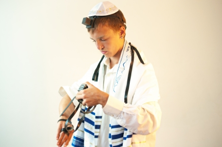 siddur: Religious Jewish teenager with a book in hand