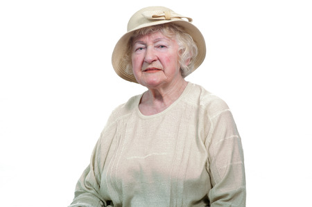 adult 80s: Portrait of  80 years old cheerful woman  on a white background.