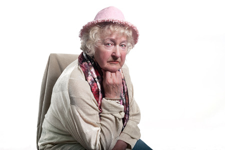 80 years: Portrait of  80 years old woman  in a hat .