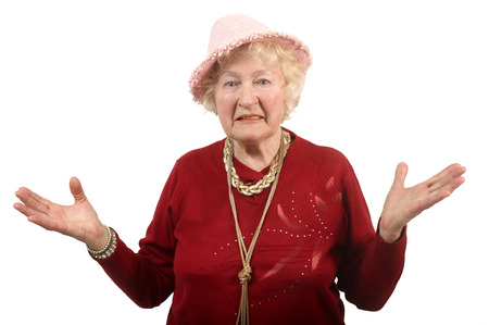 80 years: Portrait of  80 years old cheerful woman  in a pink hat .