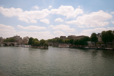 Cite Island and Pont Neuf, the oldest stone bridge across the Seine river in Paris, France Stock Photo