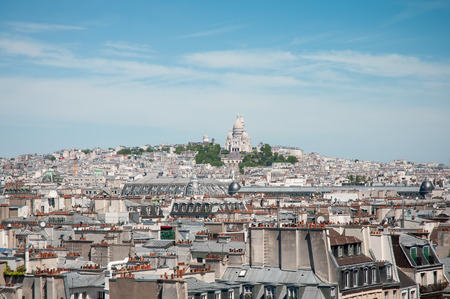 commanding: Sacre Coeur Chruch situated in a commanding position over Paris. Stock Photo