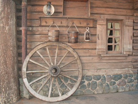 household goods: Wall of the old wooden house with household goods . Stock Photo