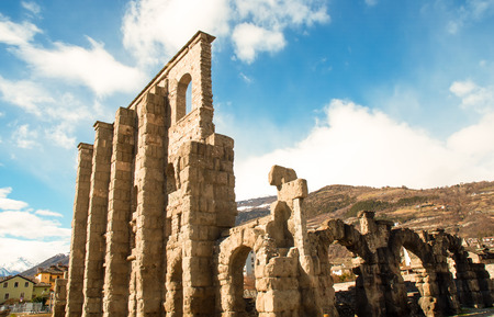 survives: The main feature of the Roman theater of Aosta is a monumental facade. This is the only part of the architectural complex with its southern side, which survives to this day. Stock Photo