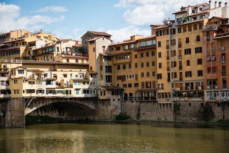 arno: Ponte Vecchio, old bridge, medieval landmark on Arno river and reflection. Florence, Tuscany, Italy.