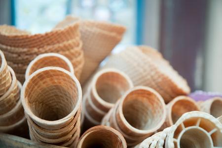 cornet: Many empty wafer sweet cornets for ice cream .
