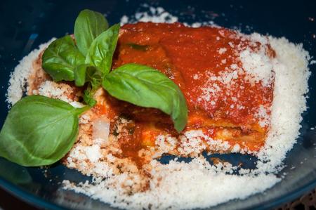 Italian food. Lasagna with Parmesan cheese and fresh basil leaves . Foto de archivo