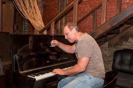 Pianist on a piano creates a beautiful musica . Standard-Bild - 133246341