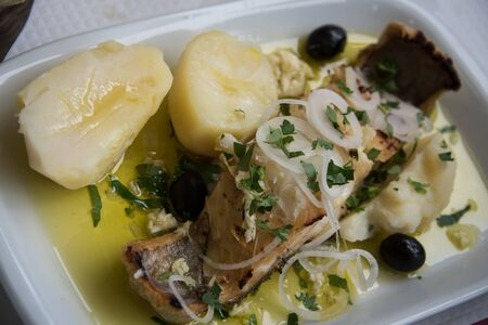 Cod and boiled potatoes - a traditional Portuguese dish.