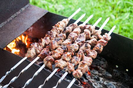 Barbecue with grilled meat and onions on chargrill.