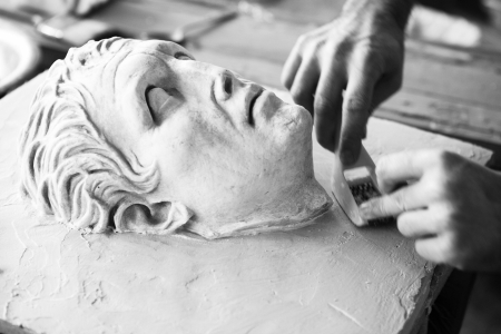 Sculptor working on head sculpture , replica of an ancient statue at Athens photo