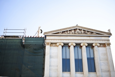 scaffolds: Athens university building at Academy of Athens with scaffolds as its been restored Editorial