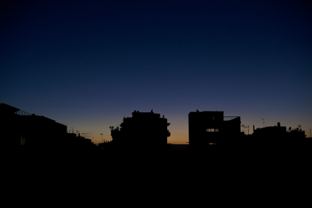 Athens Sunset,Backlit silhouettes of Athens skyline, View from Kerameikos photo
