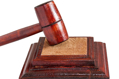 justification: Wooden gavel of judge, close-up, white background, no people, horizontal Stock Photo