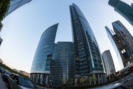 Skyscrapers of Moscow city on a summer evening. The picture was taken with a fisheye lens. Moscow, Russia.
