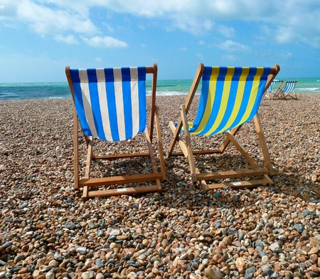 deck chairs: Deck Chairs on Brighton Beach UK Stock Photo