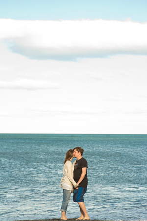 Scottish couple kissing by the sea in daylight photo
