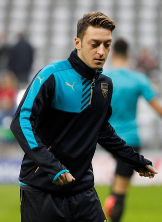 arsenal: Munich - November 4: Mesut Ozil During The heating of the Champion League match Bayern Munich - FC Arsenal at the Allianz Arena Was November 4, 2015 in Munich, Germany Editorial