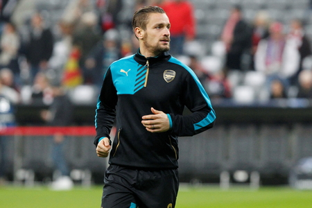 arsenal: Munich - November 4: Mathieu Debuchy During The heating of the Champion League match Bayern Munich - FC Arsenal at the Allianz Arena November 4, 2015 Munich, Germany Editorial