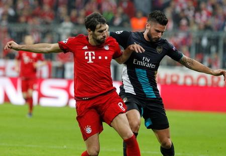 champions league: Munich - November 4: Olivier Giroud and Javi Martnez in the Champions League match Bayern Munich - Arsenal FC at the Allianz Arena November 4, 2015 Munich, Germany Editorial