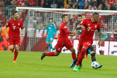 arsenal: Munich - November 4: Jrome Boateng and Thiago in the Champions League match Bayern Munich - Arsenal FC at the Allianz Arena November 4.2015 Munich, Germany Editorial