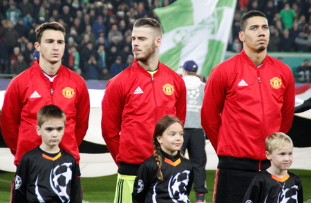 Matteo Darmian, David De Gea and Chris Smalling During The heating of the Champion League match Wolfsburg - Manchester United 8 December 2015 at the Volkswagen Arena Stadium in Wolfsburg, Germany Editorial