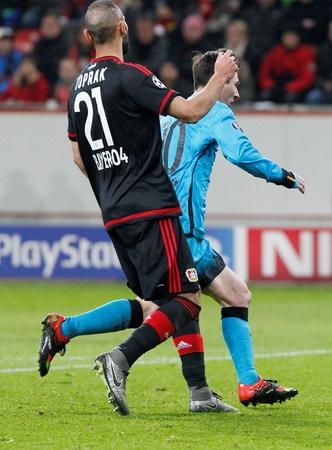 Toprak sea and Lionel Messi During heating champion league match Bayer Leverkusen - FC Barcelona December 9, 2015 at the BayArena stadium in Leverkusen, Germany