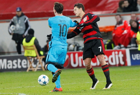 lionel messi: Lionel Messi and Javier Hernandez During heating champion league match Bayer Leverkusen - FC Barcelona December 9, 2015 at the BayArena stadium in Leverkusen, Germany Editorial