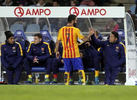 liga: SAN SEBASTIAN, SPAIN - April 6, 2016 Arda Turan Barcelona in action During the La Liga match espagolde Real Sociedad - FC Barcelona at Anoeta Stadium