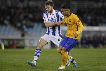 liga: SAN SEBASTIAN, SPAIN - April 6, 2016 Neymar Jr. Barcelona in action During the La Liga match espagolde Real Sociedad - FC Barcelona at Anoeta Stadium in San Sebastian, Spain Editorial