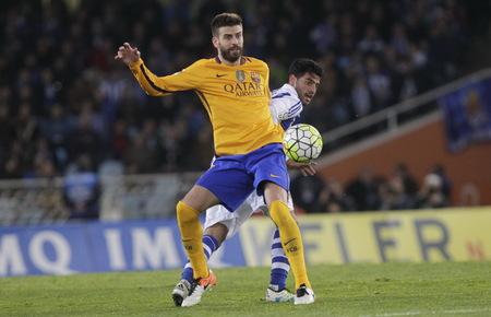 liga: SAN SEBASTIAN, SPAIN - April 6, 2016 Lionel Piqua  Barcelona in action During the La Liga match espagolde Real Sociedad - FC Barcelona at Anoeta Stadium