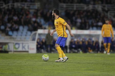liga: SAN SEBASTIAN, SPAIN - April 6, 2016 Arda Turan Barcelona in action During the La Liga match espagolde Real Sociedad - FC Barcelona at Anoeta Stadium in San Sebastian, Spain