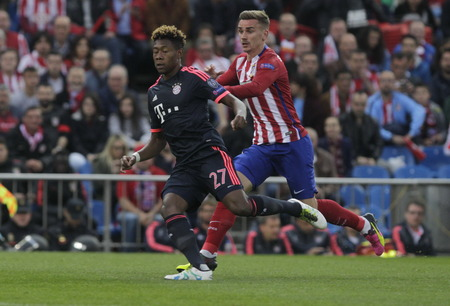 champions league: MADRID, SPAIN - April 27, David Alaba and Antoine Griezmann in Action During the semifinal match of the UEFA Champions League first leg entre Atletico Madrid and the Bayen Munich at the Vicente Calderon April 27, 2016 Madrid, Spain