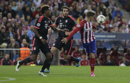 champions league: MADRID, SPAIN - April 27: Antoine Griezmann and David Alaba in action During the semifinal match of the UEFA Champions League first leg entre Atletico Madrid and the Bayen Munich at the Vicente Calderon April 27, 2016 Madrid, Spain