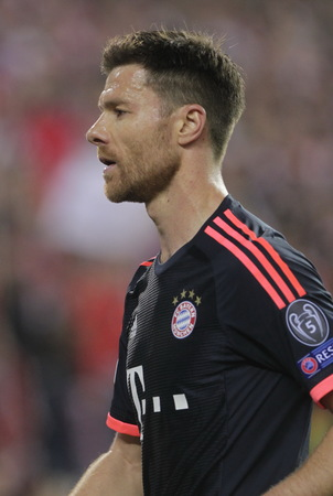 champions league: MADRID, SPAIN - April 27: Xabi Alonso in action During the semifinal match of the UEFA Champions League first leg between Atletico Madrid and the Bayen Munich at the Vicente Calderon April 27, 2016 Madrid, Spain Editorial