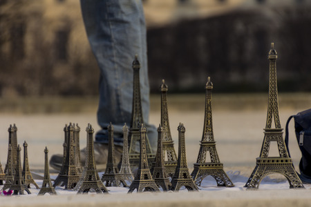 martinez: Feet behind some replicas of the eiffel tower